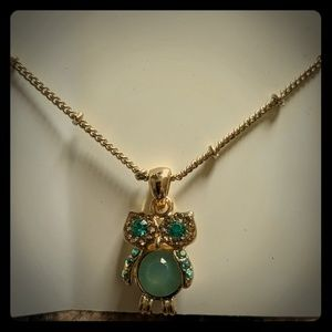 Charming Charlie's gold owl necklace